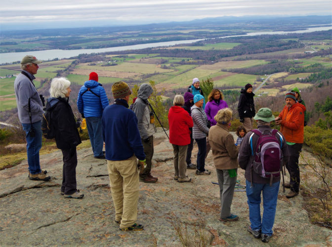 A group of hikers stands at the top of Big Hollow/Coot Hill, one of four hikes that make up the new Moriah Challenge. (Photo provided)