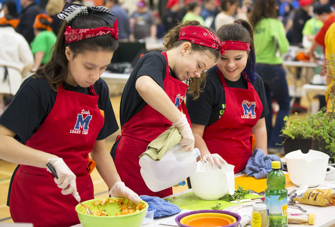 Farmin' Chefs, a middle school team from Saranac Lake Central School District, prepare Farmers' Pie at North Country Jr. Iron Chef 2017, which was held March 11. The competition is a regional event that spans Clinton, Essex, Franklin, Hamilton, Jefferson, Lewis and St. Lawrence counties with 23 middle and high school teams competing to develop healthy recipes, using a combination of local and USDA (commodity) foods that could be realistically prepared in a school cafeteria. (Photo provided — Jason Hunter for the Health Initiative)