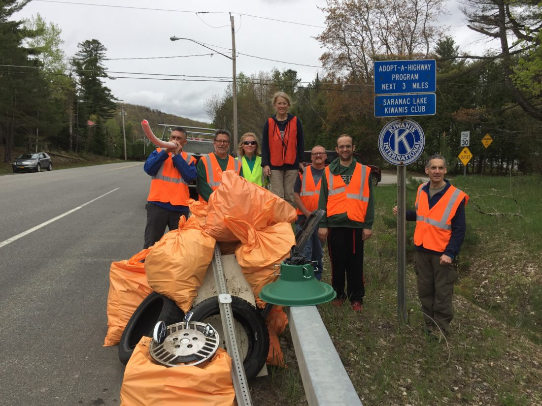 Members of the Saranac Lake Kiwanis Club and Aktion Club were out cleaning state Route 3 on May 13. They found everything from a Christmas tree stand to tires and lots of beer bottles. Pictured are Craig Stevens (with musical noodle), Keith Freeman, Susan Kieffer, Judi Nisson, Bob Lawrence, Rickie Sullivan, and Dan Reilly.  Not pictured are Flora Paganelli and Lonnie Ford. (Photo provided)