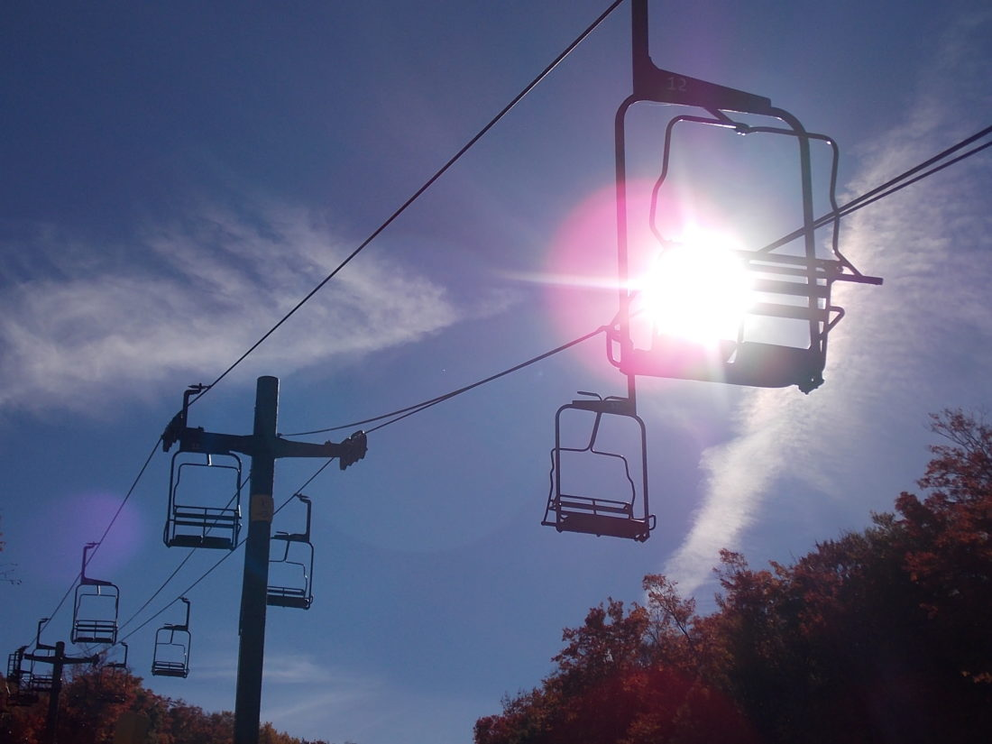 The sun shines through Chair 2 at Big Tupper Ski Area in October 2016.  (Enterprise photo — Brittany Proulx)