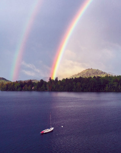 A double rainbow shines Tuesday over Mirror Lake in Lake Placid.  (Photo provided — Deb Ward)
