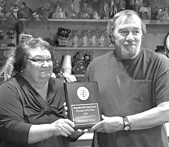 The Piercefield Volunteer Fire Department and Ladies Auxiliary held their 19th annual banquet on May 19 at the Thirsty Moose in Childwold. Officers received gifts in appreciation of their leadership contributions. Richard Riley of Childwold, right, was awarded the Fireman of the Year honor and Patricia Reandeau, left, was awarded the Ladies Auxiliary Member of the Year. Officers for the new year are Chief Leo Sarazen, First Assistant Chief Josh Trudeau, Second Assistant Chief Jim Brownell, Captain Mark McCuen, Treasurer Robert Ashton and Secretary Jill Bush. Ladies Auxiliary officers this year are President Patricia Reandeau, Vice President Elaine Sarazen, Secretary Karolyn Benware, Treasurer Audrey LaVasseur, Chaplain Judy Courtney and Historian Stacey Gensel. (Photo provided)