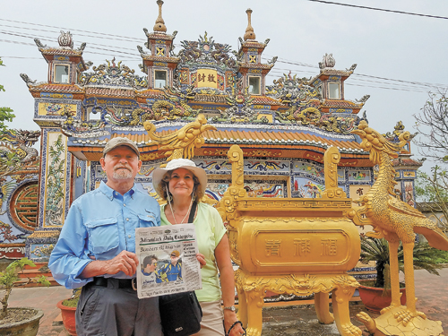 John Radigan and Cheryl Culotta display a copy of the Enterprise at a local family shrine in Hue, Vietnam.