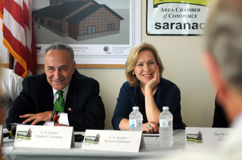 Sens. Charles Schumer and Kirsten Gillibrand visit the Adirondack Regional Airport in Lake Clear in August 2011