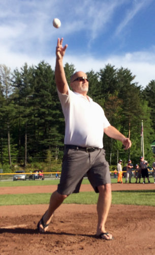 "The Saranac Lake Area Youth Baseball and Softball Association recognized Richard ""Dick"" Zerrahn, who passed away in February, on Wednesday on its opening day. Zerrahn was a physical education teacher in the Saranac Lake Central School District for 32 years who coached boys and girls teams at the modified, junior varsity and varsity levels in nearly every sport. In total, he coached more than 100 teams, which works out to thousands of students, during his career. In this photo, his brother Dave Zerrahn throws out a first pitch in his honor. (Enterprise photo — Chris Knight)"