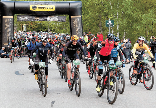 Racers take off at the start of the seventh annual Wilmington Whiteface mountain bike race Saturday. The event featured distances of 100 and 50 kilometers, racing on dirt roads and singletrack throughout the Wilmington region.  (Photo provided — Roy Bombard)