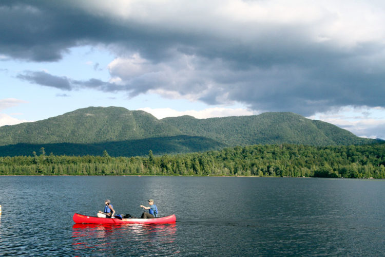 Paddlers make their way across Middle Saranac Lake. (Photo provided —Mike Lynch)