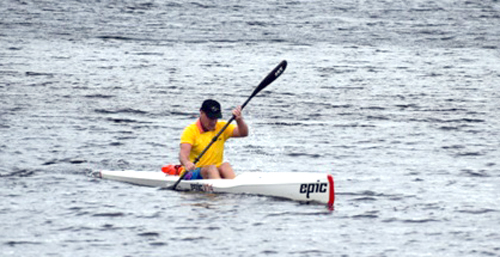 Ed Joy, of Poolsville, approaches the finish line to post the fastest time of Saturday's Tupper Lake 8-Miler in an Epic V14 kayak. (Photo provided — Roger Gocking)