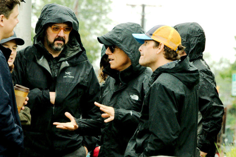 Actor and filmmaker Ben Stiller (hooded, center) braves the rain in downtown Plattsburgh with a film crew Tuesday. (Photo provided — Jason Cerone)