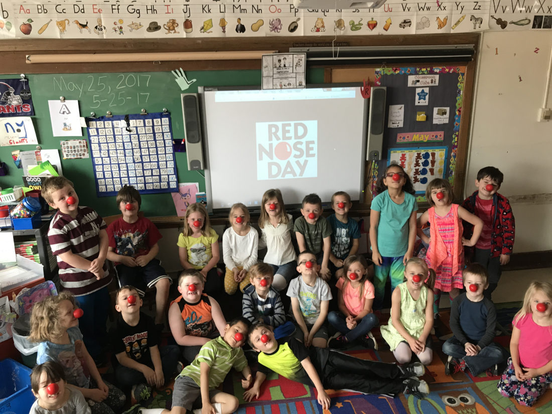 First-grade students in  Seamus Lewis' class at Petrova Elementary School in Saranac Lake marked Red Nose Day on May 25 by wearing red noses and learning about the annual event, which was founded by Comic Relief Inc. to help child poverty. Pictured in the back row, from left, are: Andrew Parker, Jasper Herd, Karissa Holmes, Lilly Kipping, Cassidy Todd, Gunner Harrison, Evan Harvey, Jetaya Wilson, Hailey Pickreign and Miles Aaron. Pictured in the middle row are Alysa Joyce, Casey Riley-Tyner, Cole Strack, Camdyn Taylor, Connor O'Shea, Jackson Daunais, Lyndsee Reardon, Katy Hoffnagle, Wyatt Sutton and Amelia Evans. Pictured in the front row are Nelson Wang and Mason Quinn. (Photo provided)