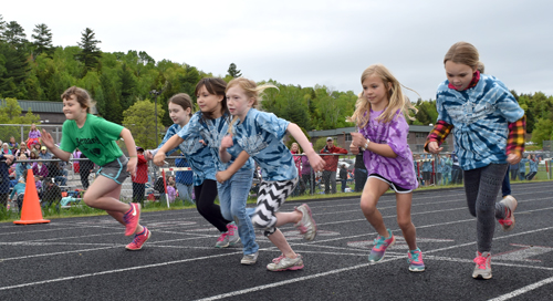Third-grade girls from Bloomingdale Elementary School, Petrova Elementary School and St. Bernard's School leave the starting line Monday in the 400-meter race at the Saranac Lake High School track during third-grade field day. (Enterprise photo — Chris Knight)