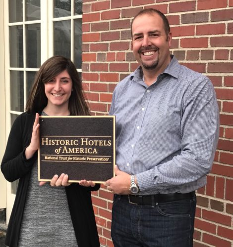 Hotel Saranac Sales Manager Carolyn Bordonaro and General Manager Michael Salyers hold the plaque commemorating the hotel's inclusion among Historic Hotels of America. (Photo provided)