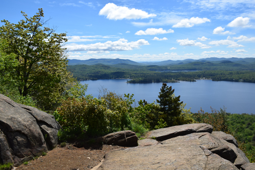 Looking to the southeast from Echo Cliffs, Piseco Lake, Spy Lake and the rolling hills of the southern Adirondacks can be seen. (Enterprise photo — Justin A. Levine)