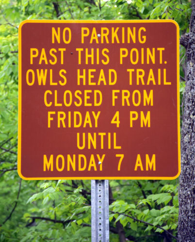 This new sign shows that the trail to Owls Head Mountain in Keene is now closed on weekends, from 4 p.m. Friday to 7 a.m. Monday. Most of the trail, as well as the trailhead, parking and access road, is on private land, and Memorial Day weekend crowds of hikers prompted the owners to stop their practice of allowing full public access. (Enterprise photo — Justin A. Levine)