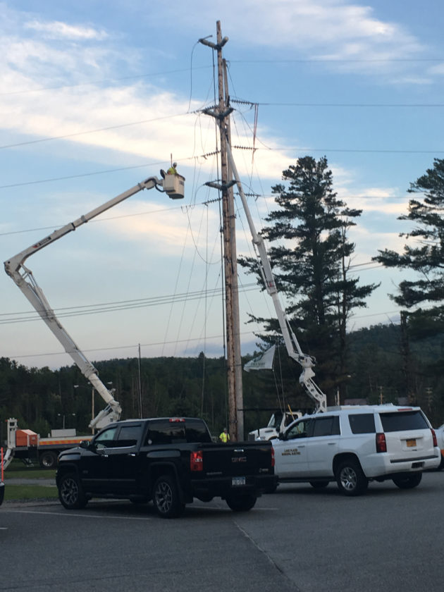 Crews from the Lake Placid Electric Department attend to the high line location where electricity failed Sunday afternoon, resulting in a 7-plus hour outage for the village of Lake Placid. (Photo provided —Craig Randall)
