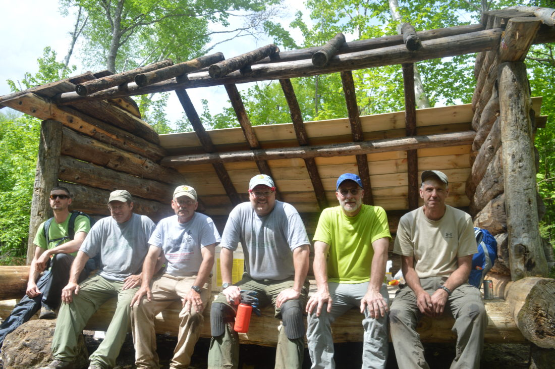 Pictured, from left to right, are Andrew Machlowski, Mike Mceaney, Doug Hamilton, Tom Fine and Brian Sikorsky — who were six of the 21 volunteers from the Adirondack 46ers trail crew who worked Saturday and Sunday to relocate the lean-to on the north fork of the Boquet River to higher ground further from the water in order to comply with current regulations. The lean-to is located 4.3 miles into the trail from Round Pond in Keene that leads to Dix Mountain. (Enterprise photo — Antonio Olivero)