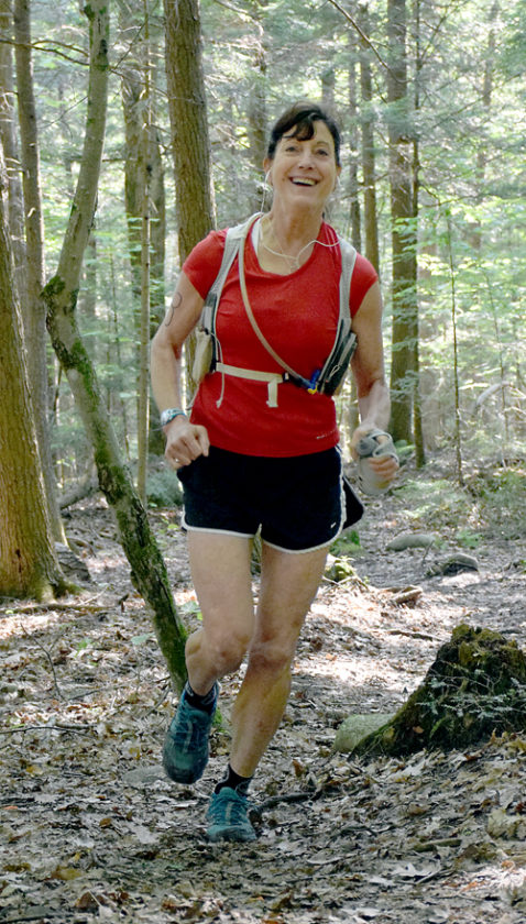 Most runners, including Laura Nardelli, were in good spirits at the start of the 11.5-mile trail run hosted by Keene Valley gear store The Mountaineer on Saturday. Nardelli went on to win the women's 50s age group.(Enterprise photo — Justin A. Levine)