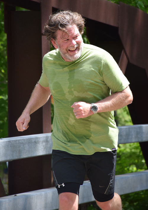 John Flanigan of Lake Placid smiles as he nears the finish line of Saturday's Great Adirondack Trail Run in Keene Valley. (Enterprise photo — Justin A. Levine)