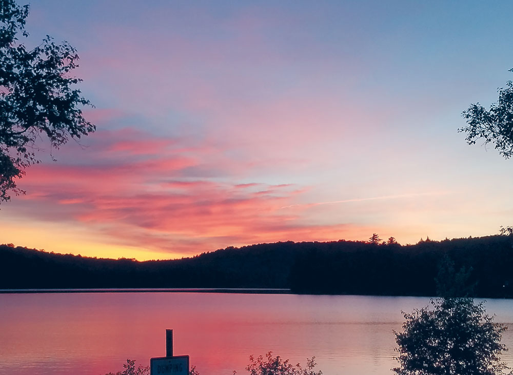 The sun sets on Lake Colby in Saranac Lake Tuesday night. (Photo provided — Amber Knapp)