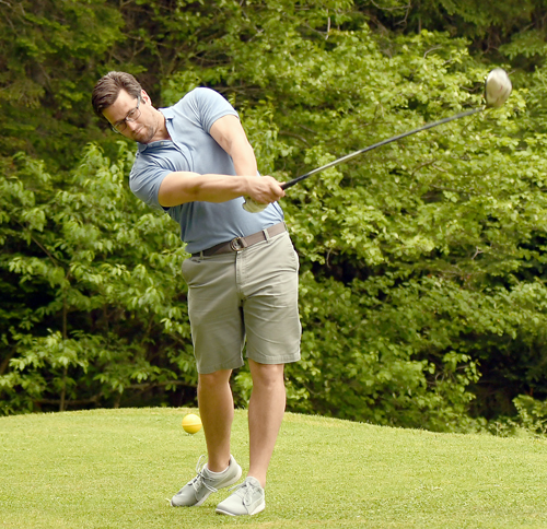 Wade Studley, playing for Murnane Builders, rips into a drive during Tuesday's tournament. (Enterprise photo — Lou Reuter)