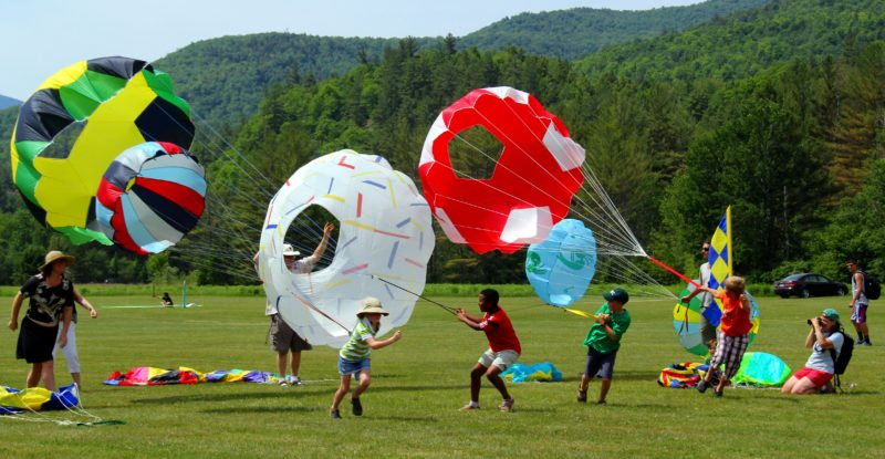Children play with kites during the annual Kite Fest on Marcy Field in Keene Valley.  (Photo provided)