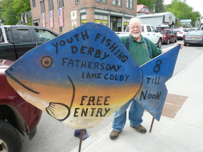 Bob Brown of the Saranac Lake Fish & Game Club poses Thursday, June 8 with a wooden sunfish he made to promote the club's annual youth fishing derby on Father's Day, Sunday, June 18, from 8 a.m. to noon. The derby is free and open to children and teenagers. (Enterprise photo — Peter Crowley)