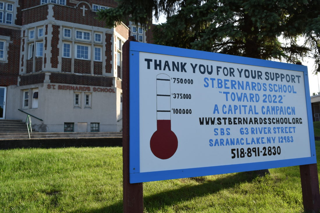 A fundraising sign outside St. Bernard's School in Saranac Lake shows the school has so far raised $50,000 toward an overall $750,000 goal. (Enterprise photo — Chris Knight)