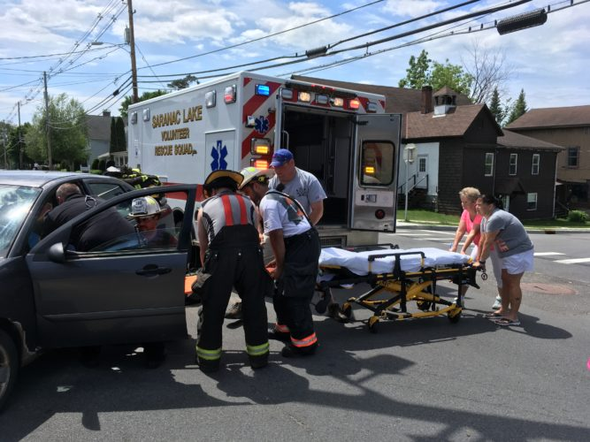 The Tupper Lake Volunteer Fire Department, along with the Saranac Lake Volunteer Rescue Squad, responded to a two-car collision at the intersection of Mill Street and Lake Street Thursday afternoon. One motorist complaining of back pain was transported to the Adirondack Medical Center in Saranac Lake. (Enterprise photo —  Ben Gocker)