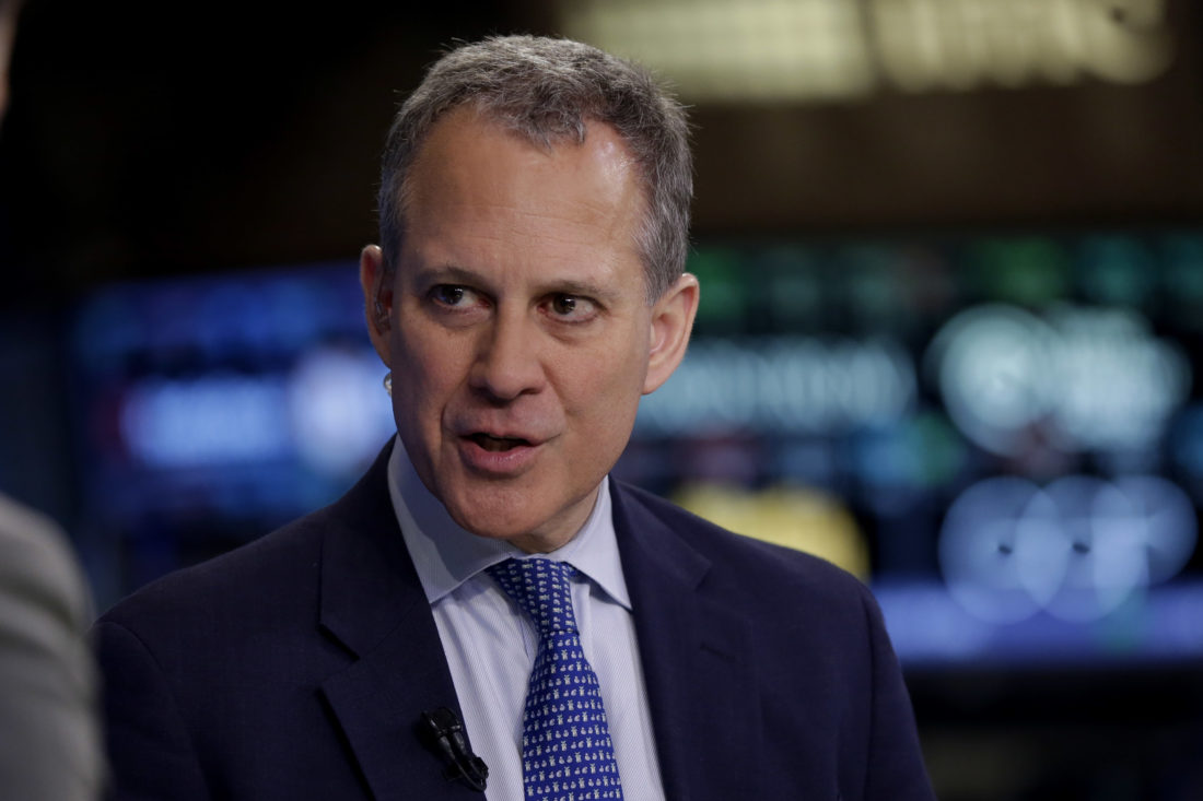 New York Attorney General Eric Schneiderman is interviewed on the floor of the New York Stock Exchange Thursday, Aug. 21, 2014.  (AP photo — Richard Drew)