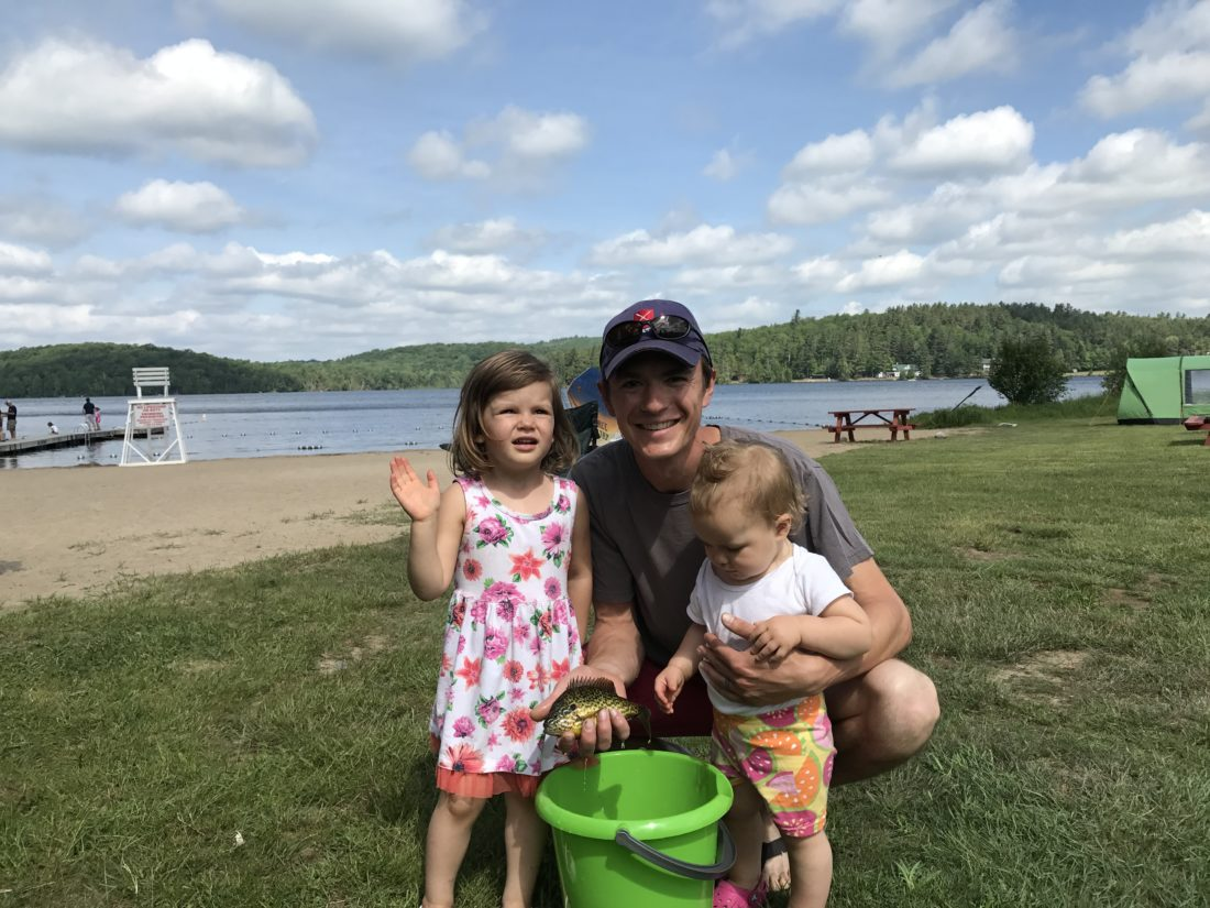 Chris Neill grew up participating in the Father's Day Fishing Derby and now shares the event with his daughters Etta, 3, and Gwen, 1. (Photo provided — Diane Chase)