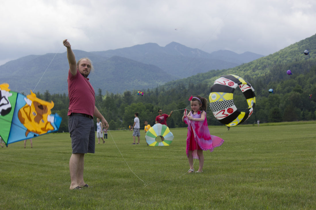 Justin Butterfield helps his daughter Jocelyn, 7, get her kite into the air.  (Photo provided —Diane Chase)