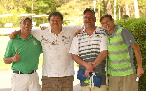 From the left, Mark Lewis, Ron Smith, Mike Noon and Tim Smith celebrate their victory Saturday in the 10th annual Larry Stringer Golf Tournament. (Enterprise photo — Lou Reuter)