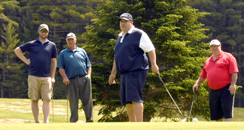 Jason Walker reacts to narrowly missing a putt while teammates, from left, Matt Bourey, Bill Vaughn and Jay Courcelle watch closely during Saturday's 10th annual Larry Stringer Golf Tournament. The foursome took second place with a nine-under par 61. (Enterprise photo — Lou Reuter)