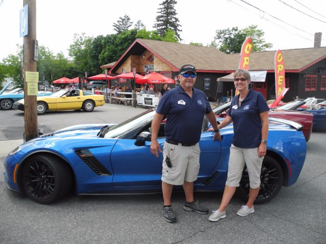 Jimmy and Sue Kimmel, members of the Syracuse Corvette Club, stand beside their 2016 Z-06 Corvette at the Big Tupper Brewing Corvette Show Saturday.  (Enterprise photo — Ben Gocker)