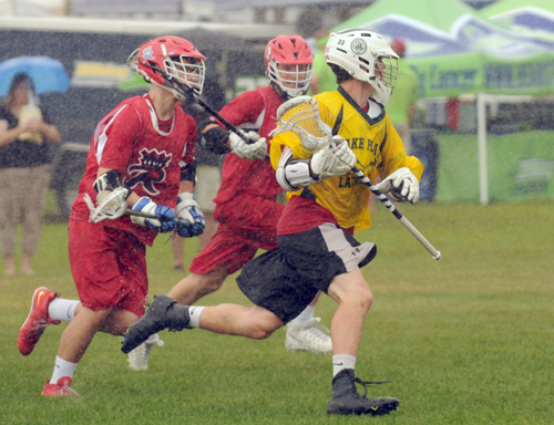 Players take part in the youth division of last August's Summit Lacrosse tournament at the North Elba fields in Lake Placid. (Enterprise file photo — Lou Reuter)