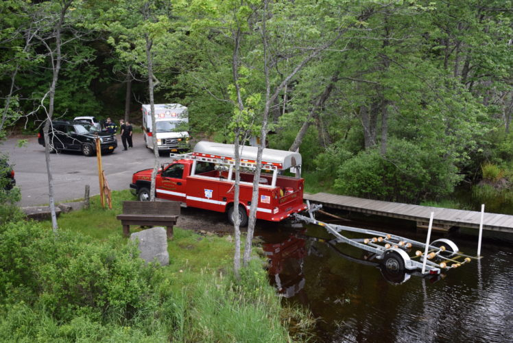 The Saranac Lake Volunteer Fire Department and Rescue Squad responded to a report of an overturned canoe in Middle Saranac Lake at 10:15 a.m. Wednesday. Crews assisted two people in the canoe. No injuries were reported. (Enterprise photo — Justin A. Levine)