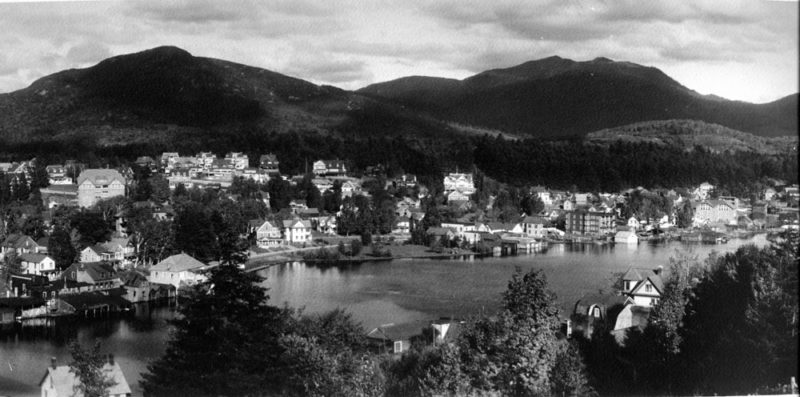 A portion of Lake Flower is seen in 1921, during the village's heyday as a health-cure center. Much of the shoreline shown here is now Riverside Park. (Photo provided by the Saranac Lake Free Library)
