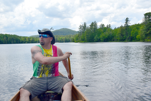 Brad Batty, of Redford, paddles along Turtle Pond last Saturday as Long Pond Mountain rises behind him. (Enterprise photo — Justin A. Levine)