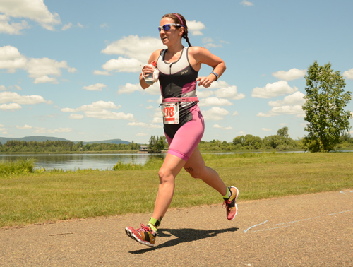 Kelly Schettini, of Sharpsburg, Georgia, runs along Raquette Pond during last year's Tupper Lake Tinman Triathlon. (Enterprise file photo — Lou Reuter)