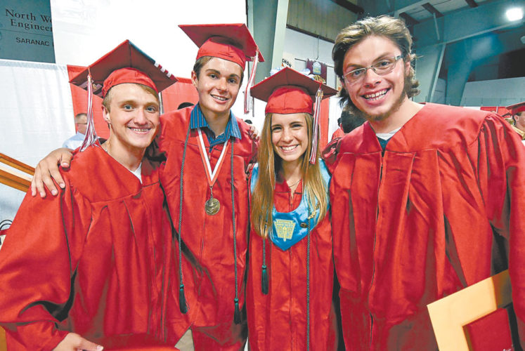 Saranac Lake High School Class of 2017 members, from left,  Logan Purner, Aaron Hesseltine, Iris Glinski and David Tracy gather for a photo following Friday's commencement ceremony. (Enterprise photo — Lou Reuter)