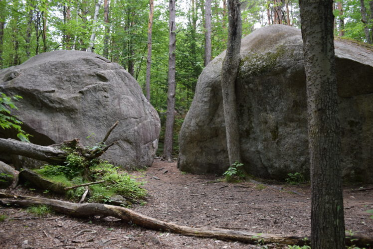 The McKenzie Boulders, seen here Monday, would be recognized and managed as a bouldering area, complete with a much larger parking area, if the Saranac Lakes Wild Forest unit management plan goes through as written. (Enterprise photo — Justin A. Levine)