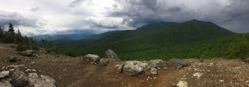 The Jay and Giant mountain wilderness areas get some rain Tuesday afternoon, as seen from the Cobble Lookout trail in Wilmington. (Enterprise photo — Justin A. Levine)