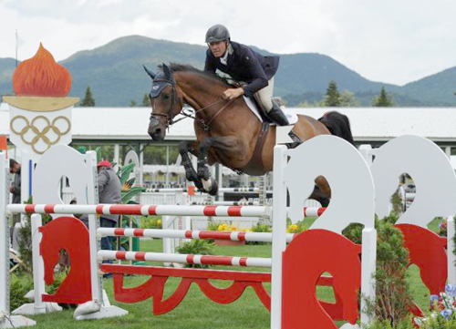 Peter Wylde and Aimee compete in Wednesday's featured competition at the Lake Placid Horse Show at the North Elba Show Grounds. (Photo — The Book LLC)