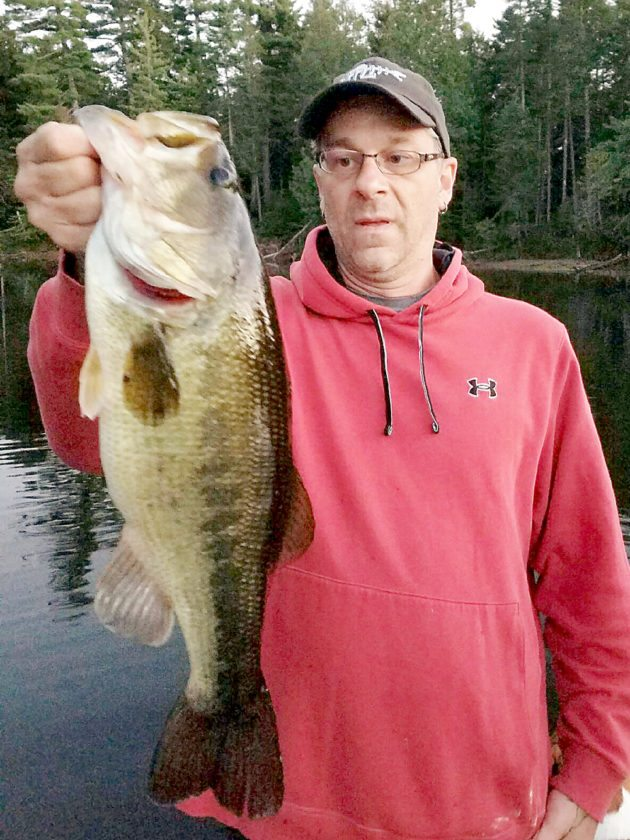 Tom Granger took this 6-plus pound largemouth bass on the Raquette River while tossing a soft bait. The fish was weighed and promptly released to fight another day.  (Photo — Joe Hackett)
