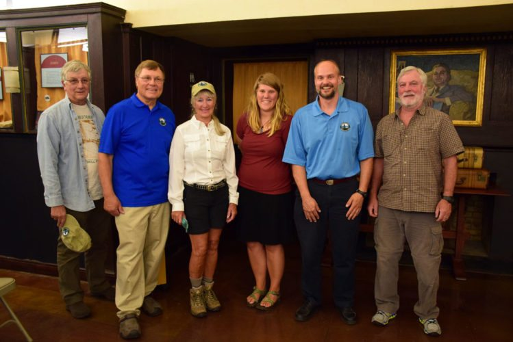 From left, Bob Marrone, Doug Fitzgerald, Scottie Adams, Janelle Hoh, David Petrelli and Richard LaBombard pose at the Saranac Laboratory Museum Monday night after a public informational meeting on the status of the St. Regis Mountain fire tower. (Enterprise photo — Justin A. Levine)