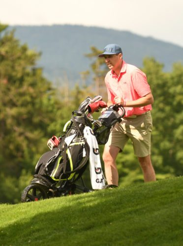 Lake Placid's Nick Politi walks around the third green at the Whiteface Club during Sunday's J. Peter Martin Whiteface Open. (Enterprise photo — Lou Reuter)