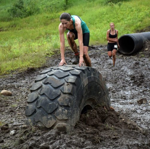 Warrior Run competitors make their way across the muddy terrain at Big Tupper Ski Area in 2016. This year, the Warrior Run will be held at a property inside the village of Tupper Lake downtown. The race starts and ends at Raquette River Brewing, 11 Balsam St., Tupper Lake. (Enterprise photo — Justin A. Levine)