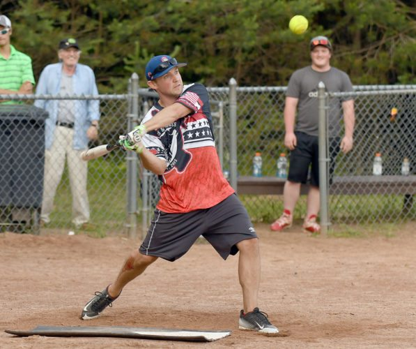 Jared Wilcox of Bitters and Bones zones in on a pitch during a Black Fly Softball League game against Romano's on Tuesday at the McKenzie Pond Road fields. The two teams played a doubleheader Tuesday, with Bitters and Bones sweeping the doubleheader by 9-5 and 7-6 scores. (Enterprise photo — Lou Reuter)