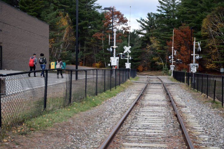 Railroad tracks run through North Country Community's College's main campus in Saranac Lake in October 2016. The state wants to buy this land so it owns all of the 34 miles of  rail corridor it plans to convert into a recreational trail. (Enterprise photo — Justin A. Levine)