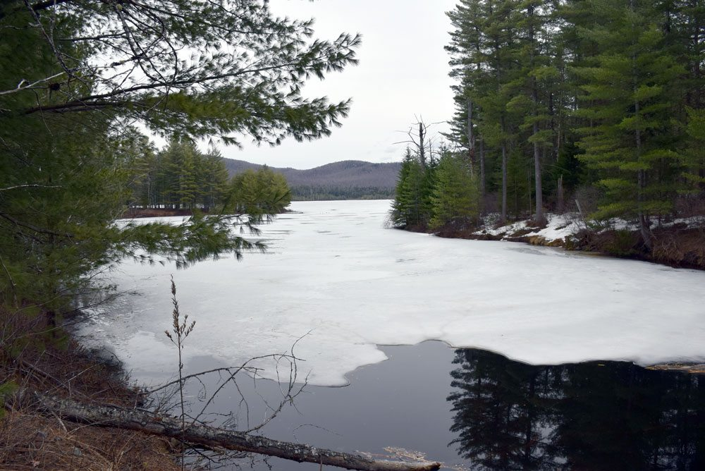 Ice thaws on Buck Pond in April. The state Adirondack Park Agency board on Thursday approved plans to upgrade the state campground at Buck Pond as well as the one at Caroga Lake. (Enterprise photo — Justin A. Levine)